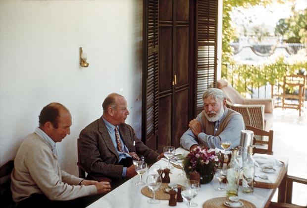 Bill Davis, Rupert Bellville, and Ernest Hemingway dining at La Consula, 1959